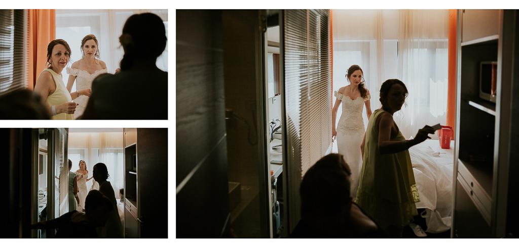 la sposa si prepara mettendo il vestito bianco